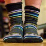 Beter warme sokken dan verwarming hoger zetten